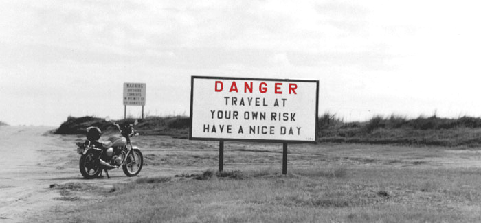 Danger Sign Travel at your own risk, have a nice day.